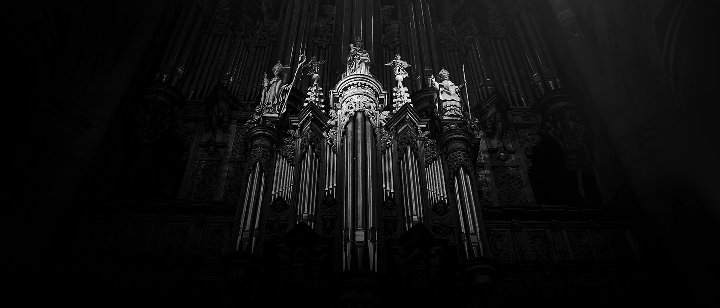 Black and White photography of a sculpture and orgue in a cathedral