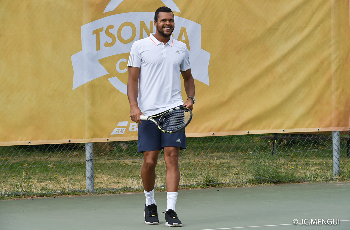 Tsonga playing tennis at his Tsonga camp behind the logo with Babolat in Lyon